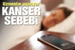 BÝLÝM ÝNSANLARI CEP TELEFONU ÝLE UYUMANIN ZARARLARINI ARAÞTIRDI